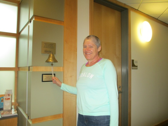 "Ringing the ""I'm done!"" bell in the radiation oncology unit at UCSD Medical."
